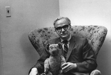 "Caption from LIFE. ""Theodore Thau, an international trade expert for the Department of Commerce, has had his teddy bear."