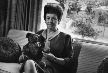 Unidentified woman with Sam, a teddy bear.