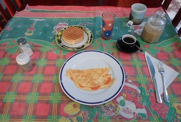 "This is the breakfast for 5 cuc that we did NOT get. ​For same money we had ""lomo de cerdo con arroz"" and drank ron Añejo 3 años."