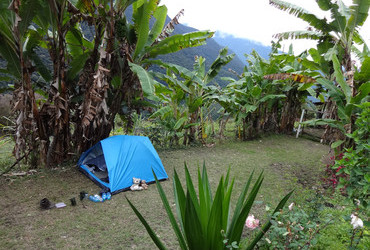 Camino precolumbino El Choro, Bella Vista, tent pitched on a football field, drinking Paceña beer - Bolivia