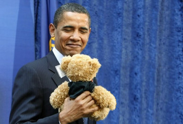 Obama holding Teddy Bear